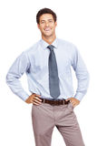 Happy young business man standing confidently Stock Photography