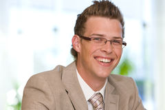 Happy young business man in suit Stock Photo