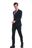 Happy young business man in suit and tie walking Royalty Free Stock Photography