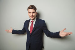 Happy young business man welcoming you Royalty Free Stock Photos