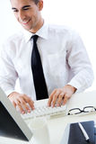 Happy young business man work in modern office on computer Stock Photos