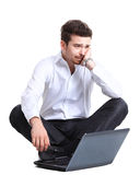 Happy young business man working on a laptop Stock Image