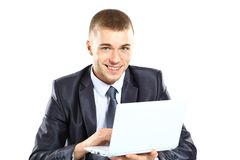 Happy young business man working on a laptop Royalty Free Stock Photography