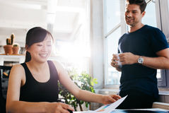 Happy young business partners working together at office Stock Photo