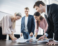 Happy young business people brainstorming at conference table royalty free stock photo