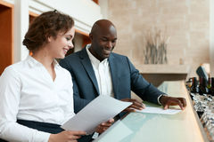 Happy young business people at cafe with some documents Royalty Free Stock Photos