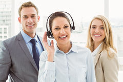 Happy young business people in office Royalty Free Stock Photos