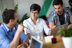 Happy young business people talking Stock Photography