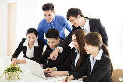 Happy young business people working in office Royalty Free Stock Image