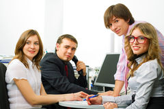 Happy young business people working at office Royalty Free Stock Photos
