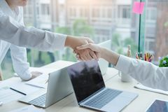 Happy young business teamwork hands shaking in office. royalty free stock image