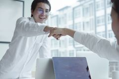 Happy young business teamwork hands shaking in office. Stock Photography