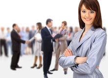 Happy young business woman. Standing in front of her team Royalty Free Stock Photos