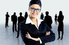 Happy young business woman. Leader and her team, Young attractive business people Stock Image
