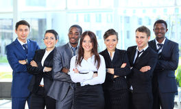 Happy young business woman. Happy young business women with her team in background Royalty Free Stock Images