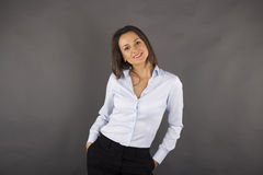 Happy young business woman with her hands in her pockets Royalty Free Stock Images