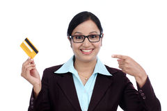 Happy young business woman holding credit card Royalty Free Stock Image