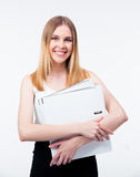 Happy young business woman holding folders Royalty Free Stock Image