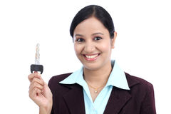 Happy young business woman holding key Royalty Free Stock Photography