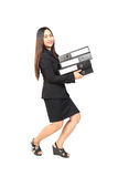 Happy young business woman holding a lot of folders Royalty Free Stock Image