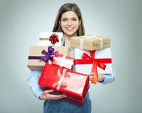 Happy young business woman holding pile of gifts. Royalty Free Stock Photo