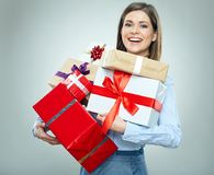 Happy young business woman holding pile of gifts. Stock Photography