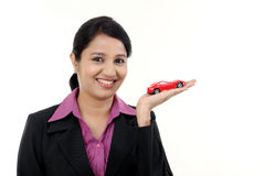 Happy young business woman holding toy car Royalty Free Stock Photo