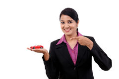 Happy young business woman holding toy car Stock Images