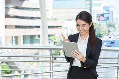 Happy young business woman with laptop working outdoor with urba. N background Royalty Free Stock Photo