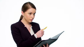 Happy Young Business Woman Making Notes Stock Photography