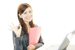 Happy young business woman making ok sign Stock Images
