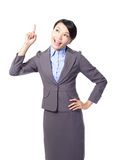 Happy young business woman pointing something Royalty Free Stock Photos
