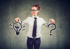 Happy young business woman with question and an answer idea light bulb stock image