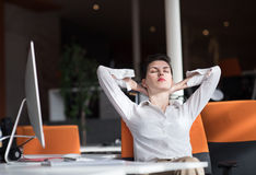 Happy young business woman relaxing and geting insiration Stock Image