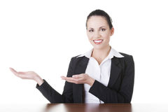 Business woman showing copy space on her palm Royalty Free Stock Photos