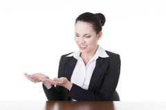 Business woman showing copy space on her palm Royalty Free Stock Images