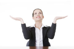 Business woman showing copy space on her palm Stock Photo