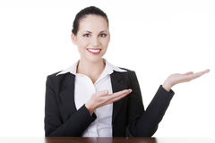 Business woman showing copy space on her palm Stock Photography