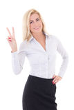 Happy young business woman showing peace sign isolated on white Stock Image