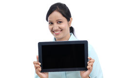Happy young business woman showing tablet Stock Image