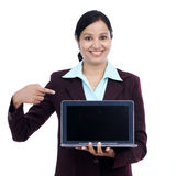 Happy young business woman showing tablet computer Royalty Free Stock Photo