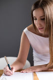 Happy young business woman signing document Stock Image