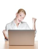 Happy young business woman sitting at the table. Happy young business woman sitting at a desk with laptop, isolated Stock Photos