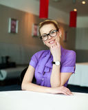 Happy young business woman sitting at the table Stock Images