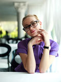 Happy young business woman sitting at the table Stock Photography