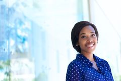 Happy young business woman standing outdoors Stock Photo
