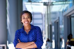 Happy young business woman standing outside office building Royalty Free Stock Photography