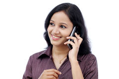 Happy young business woman talking on cell phone Royalty Free Stock Image