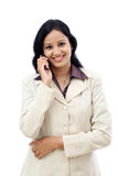 Happy young business woman talking on cell phone. Against white background Royalty Free Stock Image