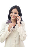 Happy young business woman talking on cell phone. Against white background Royalty Free Stock Photography